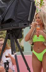 AMBER TURNER in Bikini at a Photoshoot in Ibiza 05/29/2019