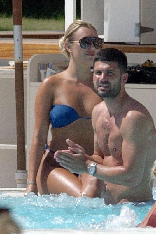 AMBER TURNER in Bikini at a Pool in Ibiza 05/29/2019