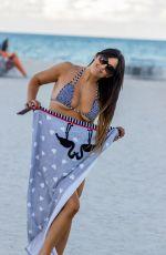 CLAUDIA ROMANI in Bikini on the Beach in Miami 05/30/2019