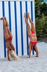 CLAUDIA ROMANI nad DAISY JAE in Bikinis Doing Yoga in South Beach 06/23/2019