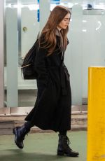 LILY COLLINS at Heathrow Airport in London 04/24/2019