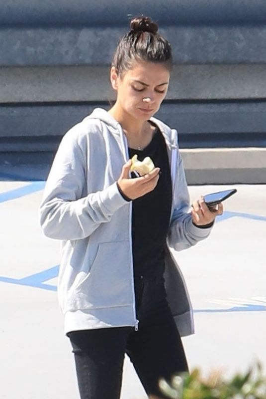 MILA KUNIS Eating Apple Out in Beverly Hills 06/27/2019