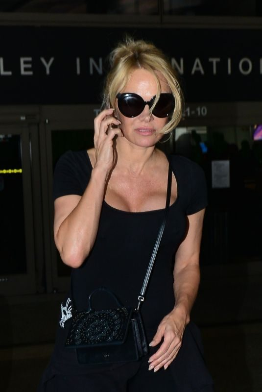 PAMELA ANDERSON Arrives at LAX Airport in Los Angeles 06/05/2019