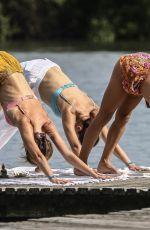 ALESSANDRA AMBROSIO in Bikini Doing Yoga on the Beach in Florianopolis 07/03/2019
