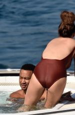 CHRISSY TEIGEN in Swimsuit at a Boat in Portofino 07/02/2019