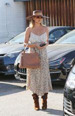 CHRISSY TEIGEN Leaves Meche Salon in Beverly Hills 07/17/2019