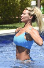 CHRISTINE MCGUINNESS in Bikini at a Pool in Spain 07/04/2019
