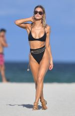 JOY CORRIGAN in Bikini at a Photoshoot on the Beach in Miami 07/15/2019