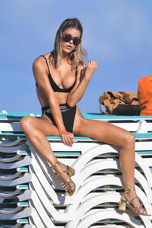 JOY CORRIGAN in Bikini at a Photoshoot on the Beach in Miami 07/15/2019