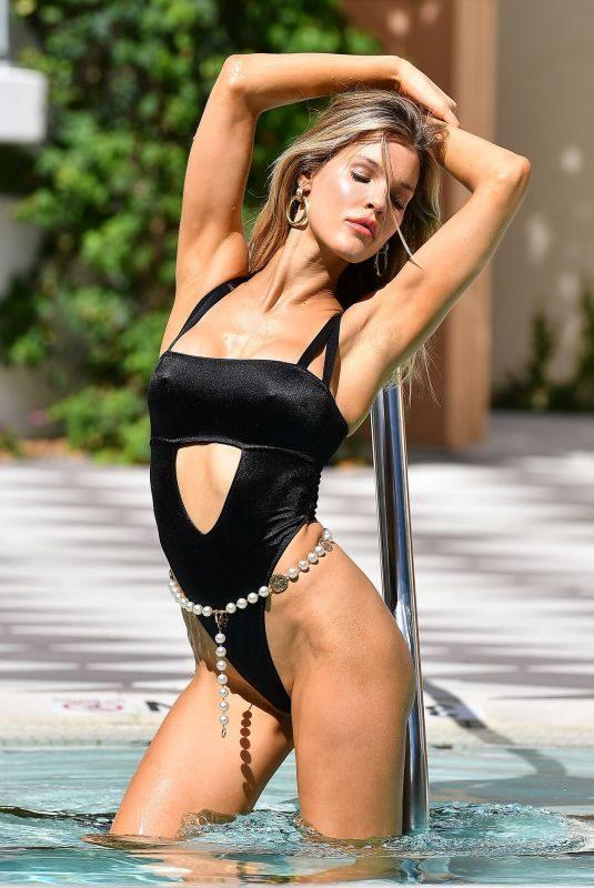 JOY CORRINGAN in Bikini on the Set of a Photoshoot at a Pool in Miami 07/11/2019