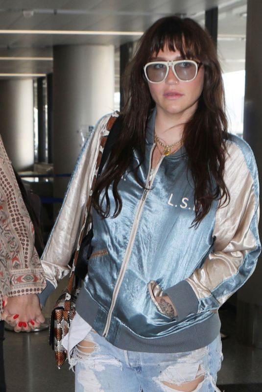 KESHA SEBERT Arrives at Los Angeles International Airport 07/04/2019