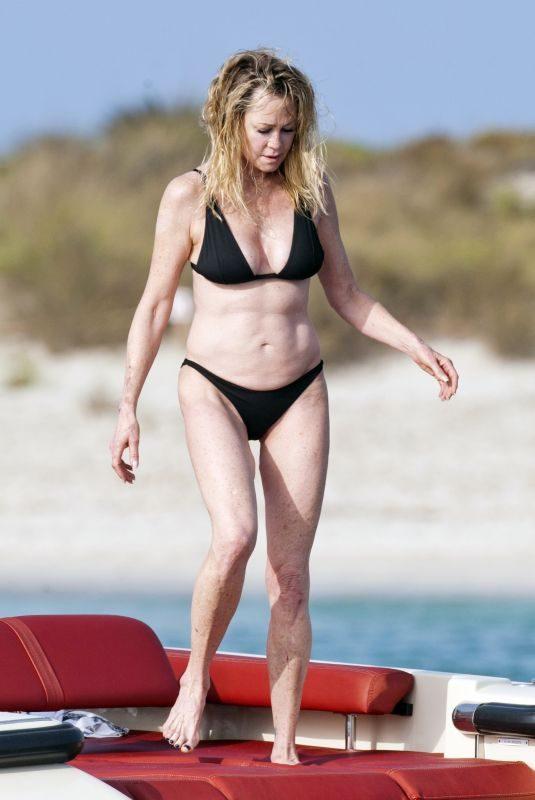MELANIE GRIFFITH in Black Bikini on Vacaton in Ibiza 07/04/2019
