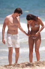 SARAH TARLETON in Bikini and Jim Chapman at a Beach in Tulum 07/16/2019