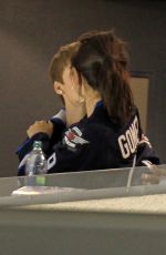 SELENA GOMEZ and Justin Bieber at a Hockey Game in Winnipeg 10/22/2011