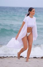 TAO WICKRATH in White Swimsuit on the Beach in Miami 07/24/2019