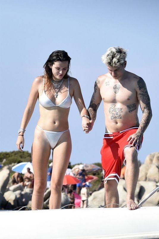 BELLA THORNE in Bikini and Beanjamin Mascolo at a Boat in Sardinia 08/21/2019