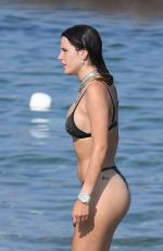 BELLA THORNE in Black Bikini on Vacation in Sardinia 08/25/2019
