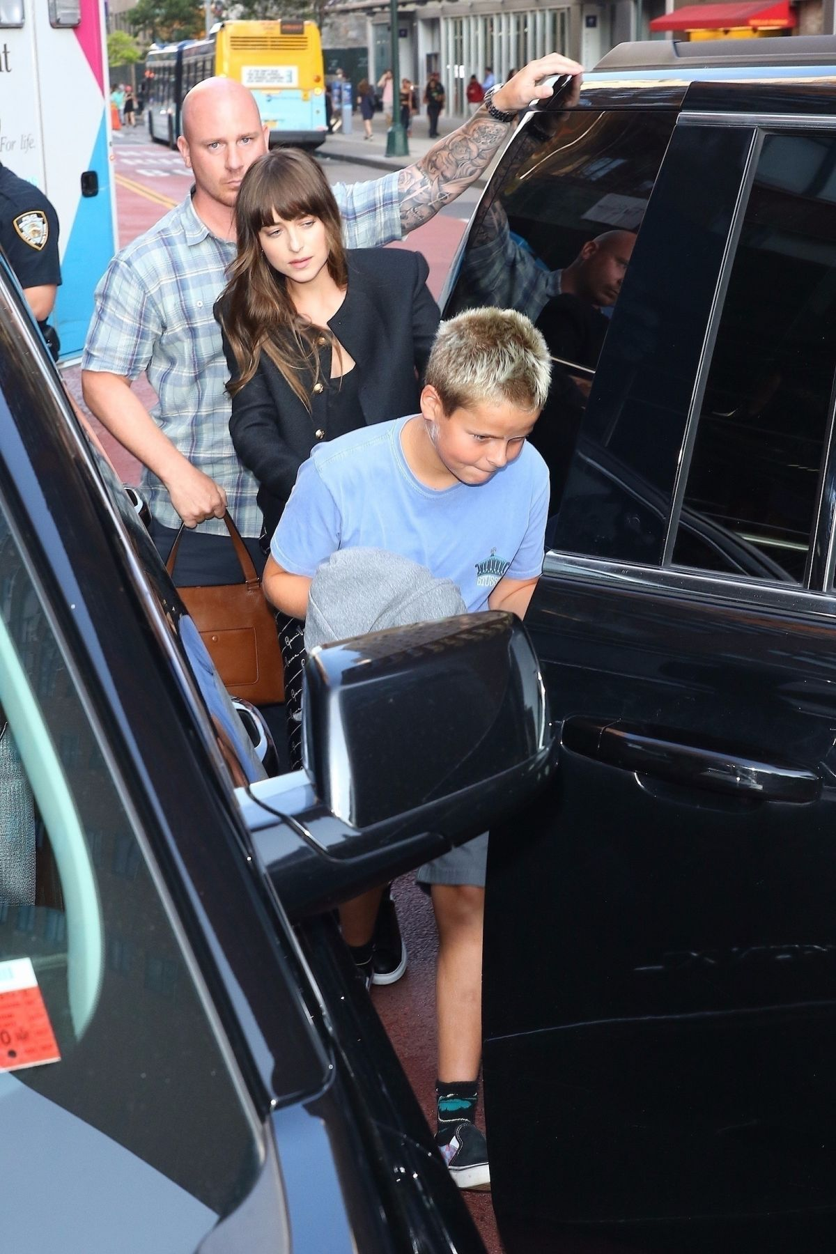 DAKOTA JOHNSON and Chris Martin Are Involved in a Car
