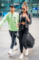 ELEANOR CALDER and Louis Tomlinson at Heathrow Airport 08/28/2019