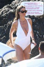 HEIDI KLUM in White Swimsuit at a Beach in Capri 08/05/2019