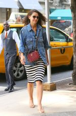 KATIE HOLMES Leaves a Cab in New York 08/18/2019