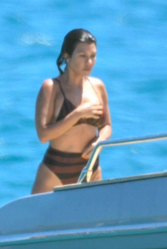 KOURTNEY KARDASHIAN in Bikini at a Boat in Sardinia 07/30/2019