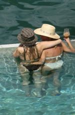 MILEY CYRUS and KAITLYNN CARTER in Bikinis at a Pool in Italy 08/11/2019