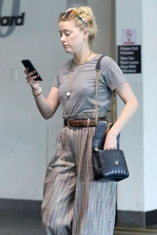 AMBER HEARD Leaves Meeting with Lawyers on Wilshire Blvd in Los Angeles 09/04/2019