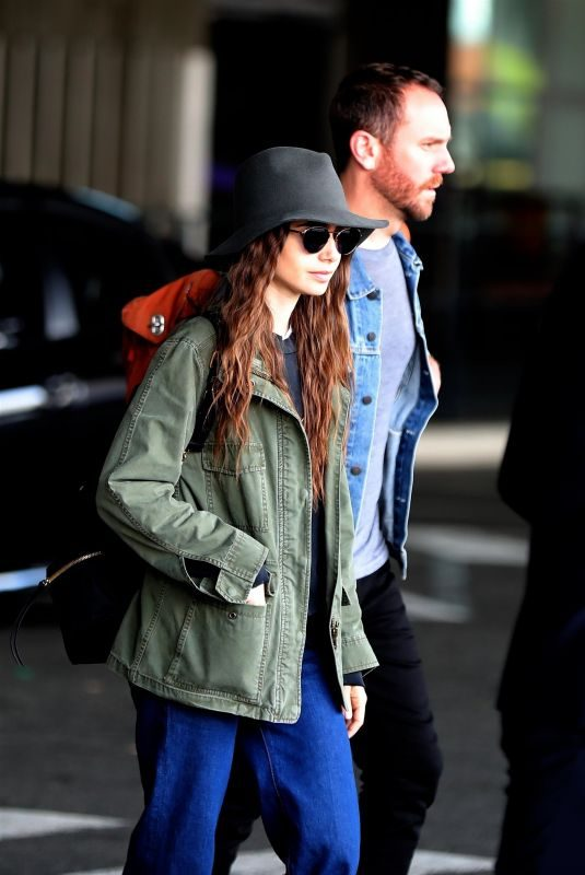 LILY COLLINS and Charlie McDowell Arrives in New York 09/08/2019