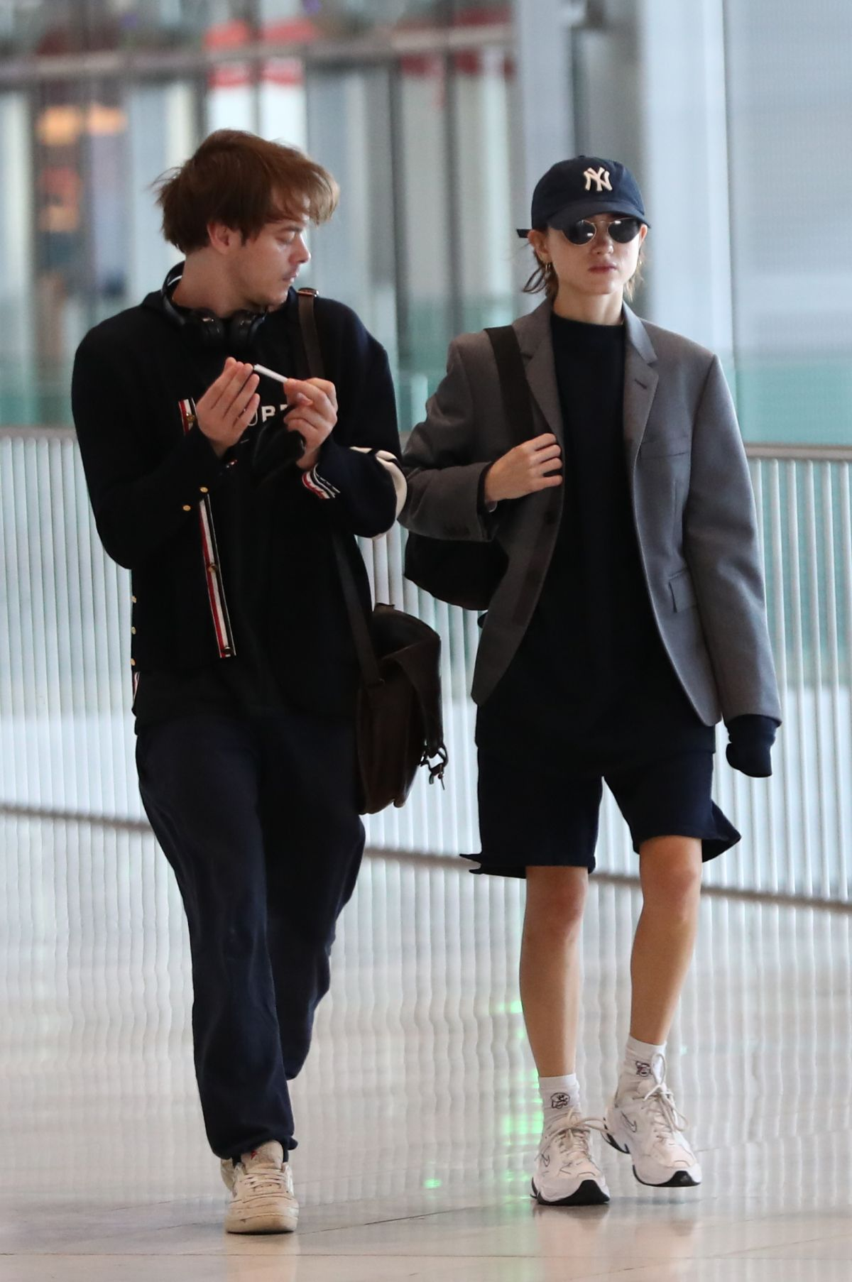 NATALIA DYER and Charlie Heaton at CDG Airport in Paris 09 ...