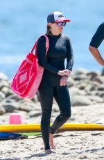 REESE WITHERSPOON Surfing at Malibu Beach 09/02/2019