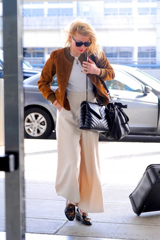 AMBER HEARD Arrives at JFK Airport in New York 10/13/2019