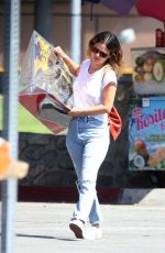 RACHEL BILSON Carries a Giant Dinosaur Model Out in Los Angeles 10/05/2019