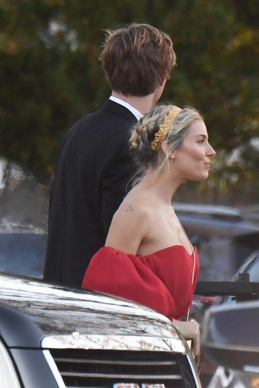 SIENNA MILLER Arrives at Jennifer Lawrence and Coke Maroney's Wedding in Newport 10/19/2019
