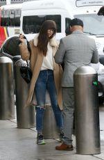 DAKOTA JOHNSON Arrives at LAX Airport in Los Angeles 11/27/2019