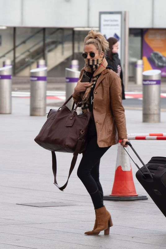 CAROLINE FLACK Arrives at Heathrow Airport in London 12/29/2019