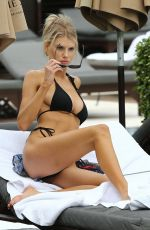 CHARLOTTE MCKINNEY in Bikini at a Beach in Miami 12/07/2019