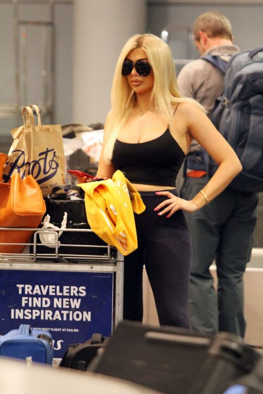 CHLE FERRY Grabbing Her Luggage at Airport in Norway 12/29/2019