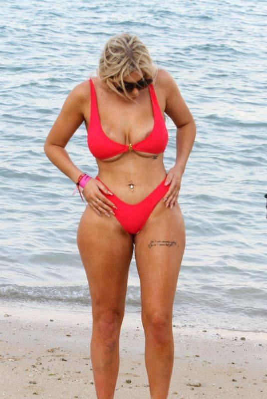 CHLOE FERRY in a Red Bikini on the Beach in Dubai 10/17/2019