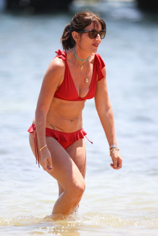DAVINA MCCALL in a Red Bikini at a Beach in Sydney 12/28/2019