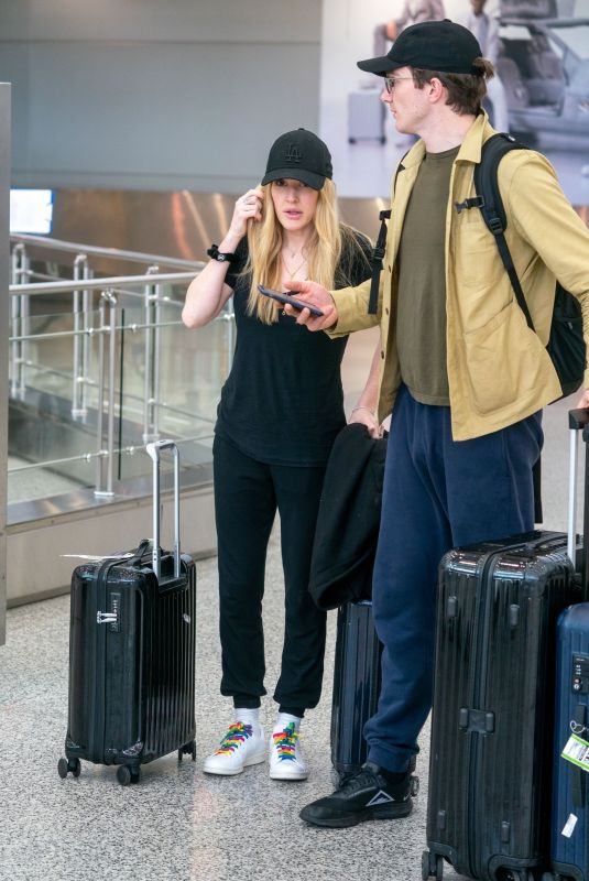 ELLIE GOULDING and Caspar Jopling at Miami International Airport 12/29/2019