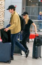 ELLIE GOULDING and Caspar Jopling at Miami International Airport 12/29/2019