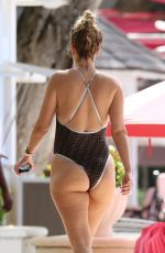RHEA DURNHAM in Black Swimsuit at a Beach in Barbados 12/29/2019