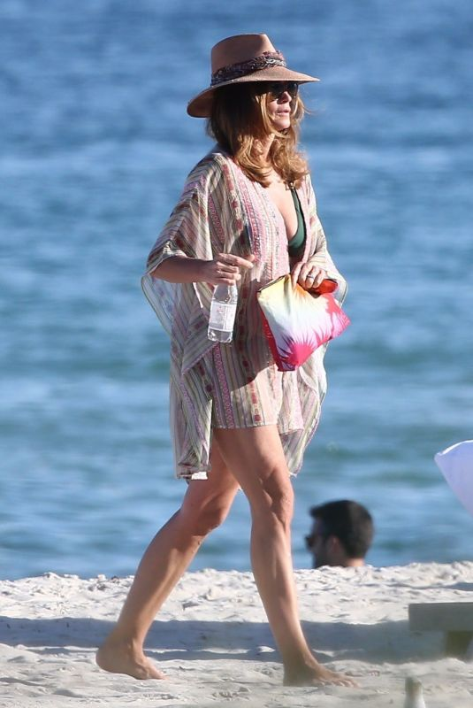 CINDY CRAWFORD on New Year's Day at a Beach in Miami 01/01/2020