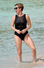 EMMA FORBES in a Black Swimsuit at a Beach in Barbados 01/01/2020