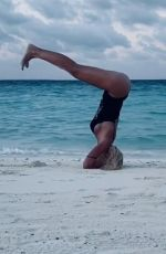 ILARY BLASI in Swismuit Doing Yoga at a Beach in Maldives 01/07/2020