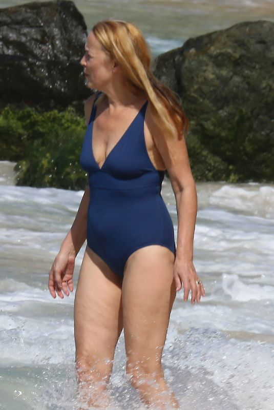 JERRY HALL in Swimsuit on the Beach in Barbados 12/30/2019