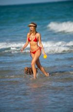 KIMBERLEY GARNER in a Red Bikini with Her Dog at a Beach in Miami 01/14/2020