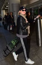 ELISABETH MOSS Arrives at LAX Airport in Los Angeles 02/23/2020