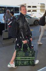 ELISABETH MOSS at Los Angeles International Airport 02/14/2020